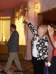 Pam raises the Trophy