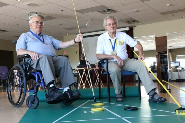 Dan Stuehrenberg, left, and Doug Campbell won gold in the floor shuffleboard Alberta 55+ Provincial Games. Tammy Marlowe Johnson