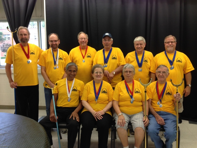 This picture was taken at the 2016 Indiana State Senior Games where 10 of the St. Louis Shuffleboard Club members competed.  Featured in this picture back row left to right: Mike Bruce, Larry Helzerman, Cliff Harvey, Dennis Squires, Glen Vanmatre, Joe Blumenkemper. Front row left to right: Sal Paez, Louise Paez, Ruth Brumback, Bob Brumback.