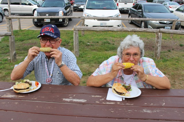 John and Dolores Enjoy Corn!! Henry Strong Donated this Corn.